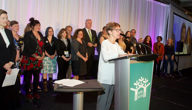 Lynne Raskin, CEO of South Riverdale Community Health Centre, speaks after accepting a Transformative Change Award for the centre's role in achieving government approval for Supervised Injection Services.