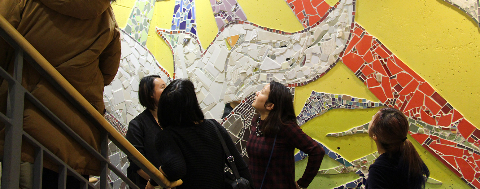 People checking out the mural at South Riverdale Community Health Centre