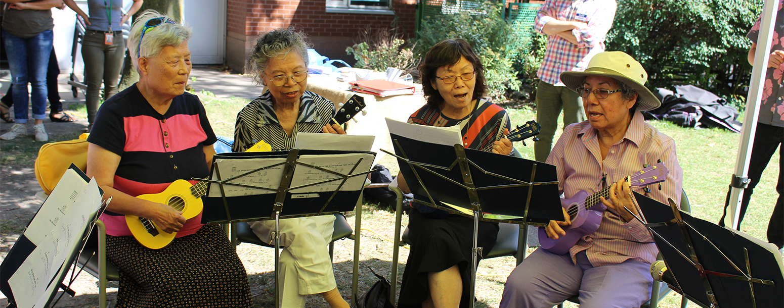 Seniors playing instruments outdoors