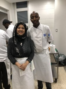 Woman and man chefs in a kitchen