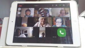 Picture of a tablet with a Seniors Zoom meeting